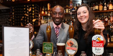 Ralph Minott and Lisa Rogers pull the real ale at The Physician 1